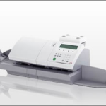 An Image Of The Neopost IJ-50 Franking Machine With Feeder